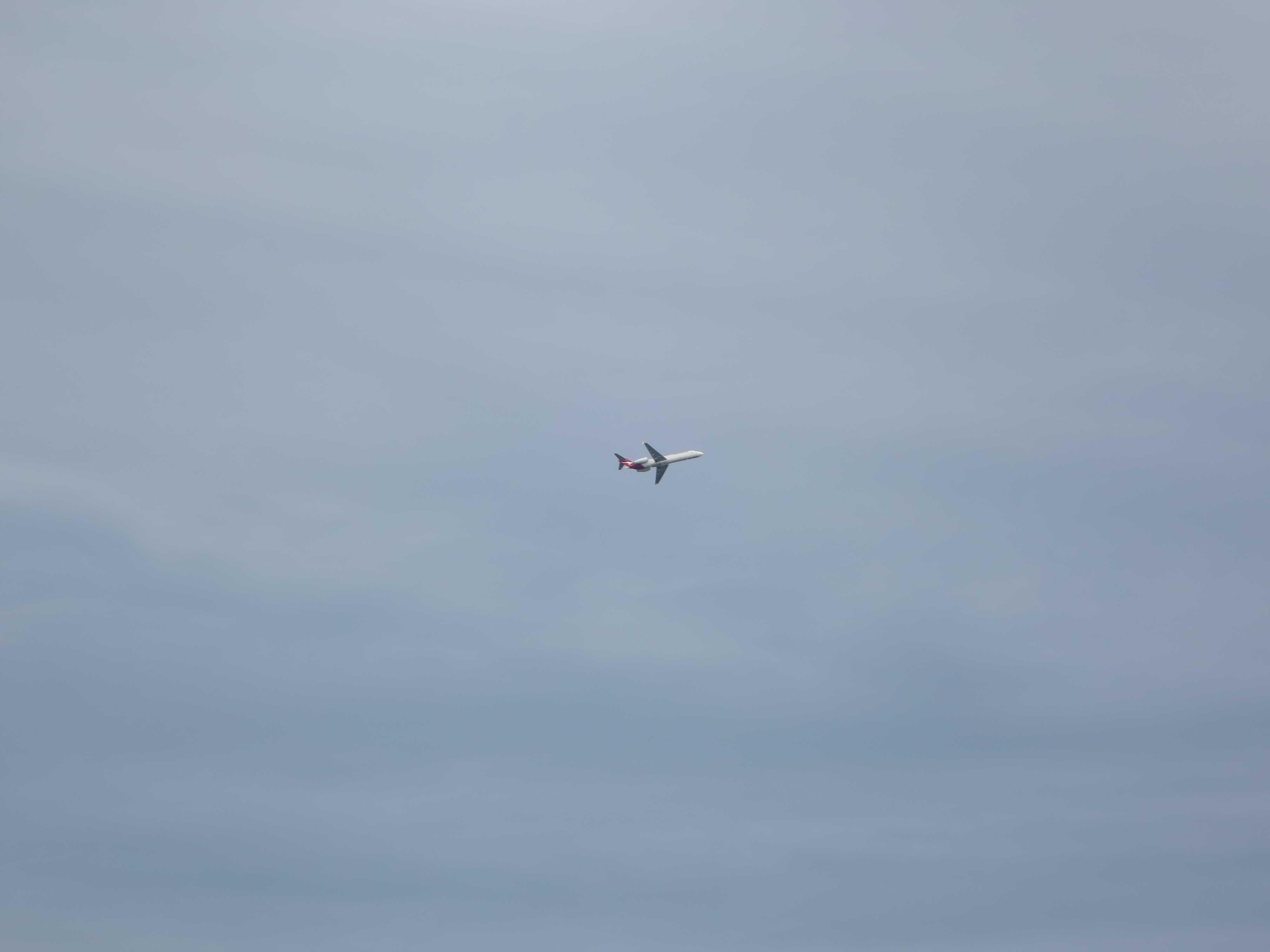 ケアンズ空港を飛び立った飛行機