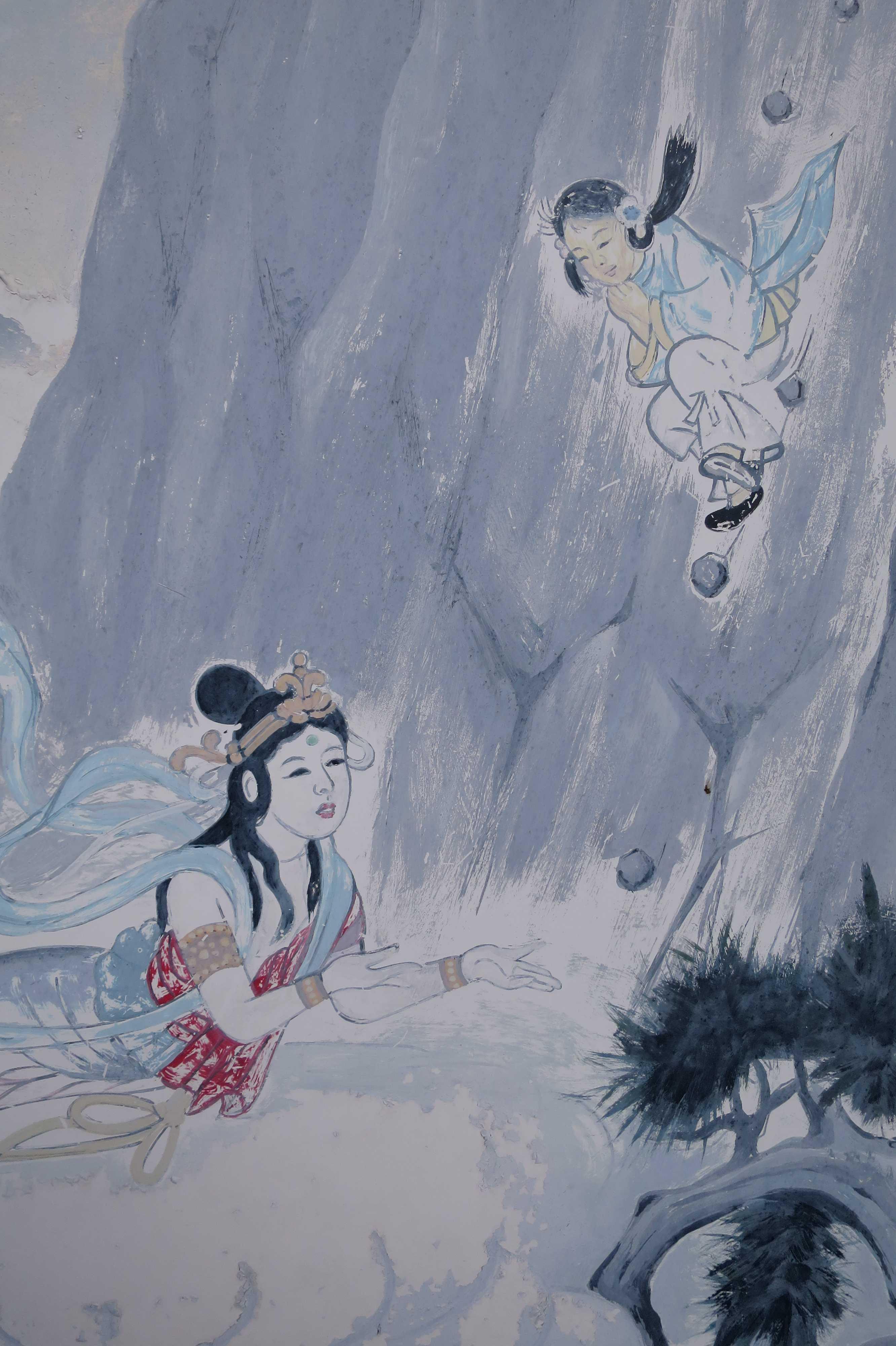 断崖絶壁から身を投じた空海少年を今まさに抱きとめようとする天女(出釈迦寺)