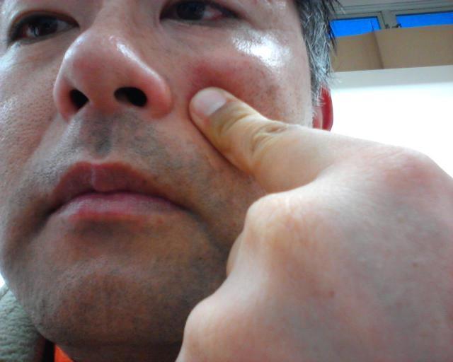 村内伸弘の顔